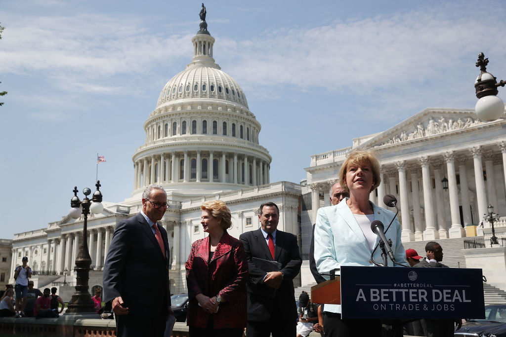 "Sen. Tammy Baldwin, D-Wisconsin, speaks alongside fellow Democratic Party members, from left, Senate Minority Leader Charles Schumer, Sen. Debbie Stabenow, and Sen. Joe Donnelly during an event to unveil ""A Better Deal On Trade and Jobs"" in front of the U.S. Capitol. 