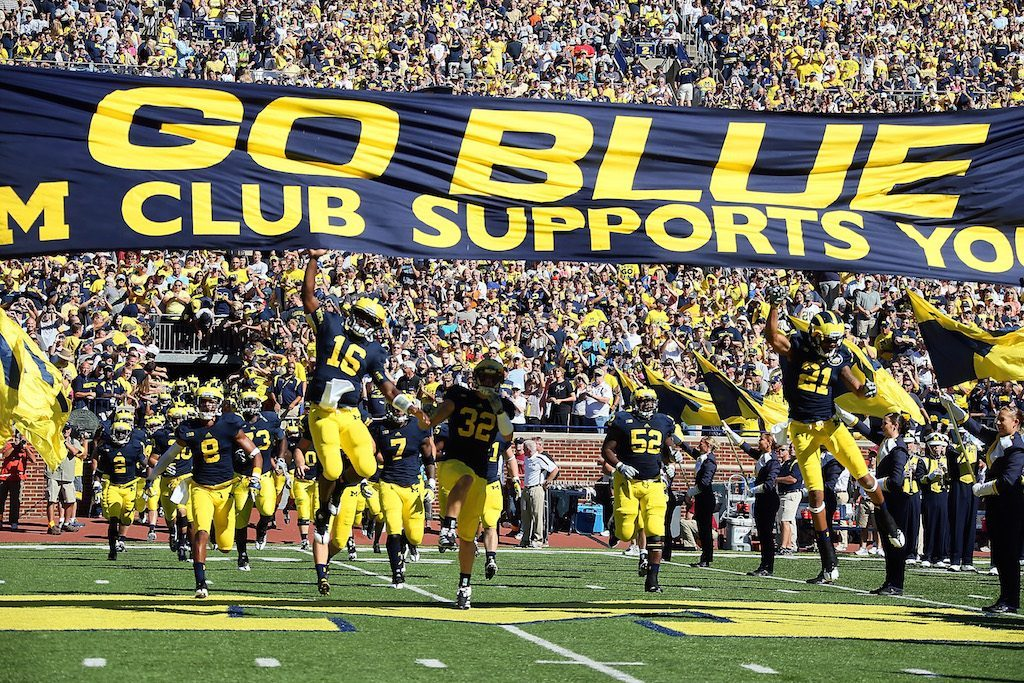 Denard Robinson #16 of the University of Michigan Wolverines leads his team to the field before a Big Ten College football game against the Univerity of Massachusetts Minutemen at Michigan Stadium on September 15, 2012 in Ann Arbor, Michigan. (Photo by Dave Reginek/Getty Images)
