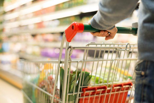 Detail of a man shopping in supermarket