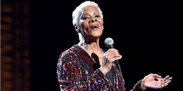 Dionne Warwick is singing on stage.