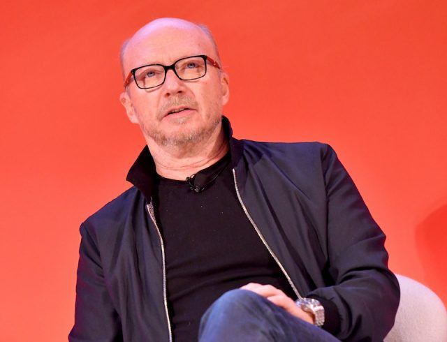 Director Paul Haggis sits onstage during a press panel.