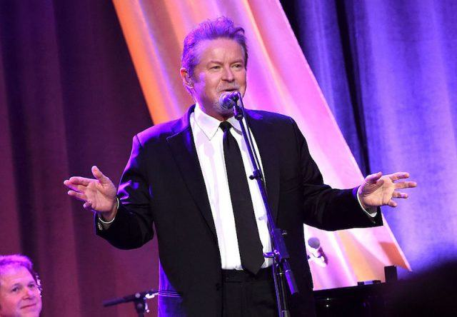 Don Henley holds his hands up to his sides and speaks into a microphone at the T.J. Martell Foundation 8th Annual Nashville Honors Gala at the Omni Nashville Hotel.