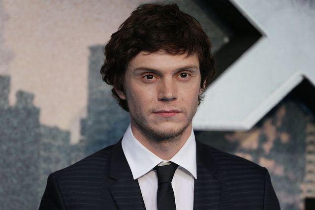 Evan Peters looks ahead while wearing a suit at a movie premiere in London.