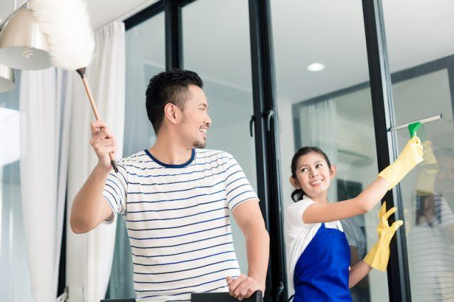 Couple cleaning their home together