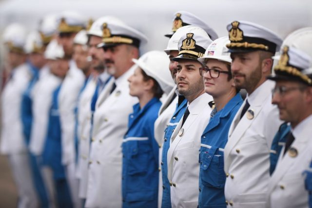 Workers and crew members gather during the delivery ceremony of the MSC Meraviglia cruise ship