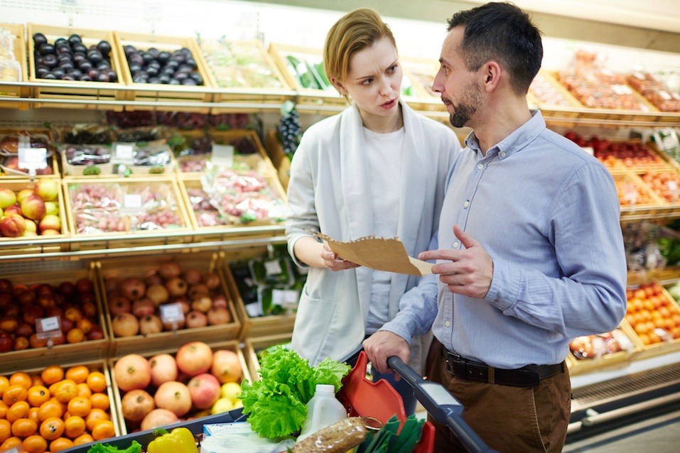 Family Discussing Shopping List in Supermarket