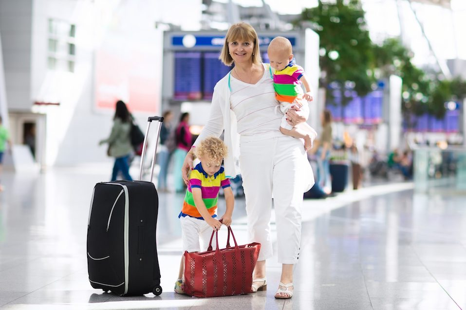 Family at airport before flight