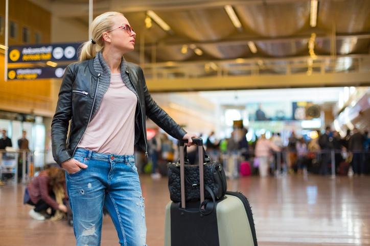 Female traveller checking flight departures