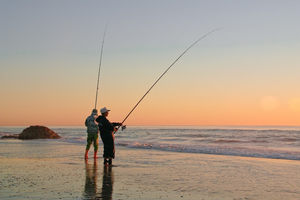 Fishing from the beach at dawn