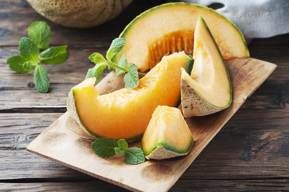 Fresh sweet orange melon and green mint
