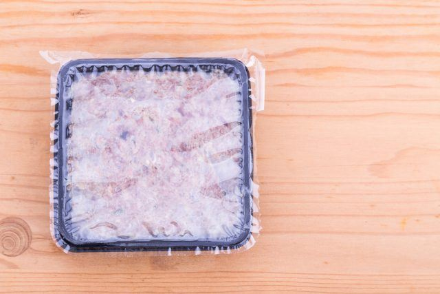 A frozen meal on a wooden table.
