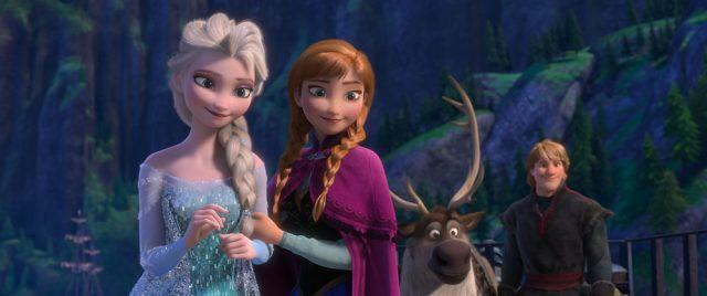 Elsa and Anna stand with a reindeer and Kristoff in Frozen