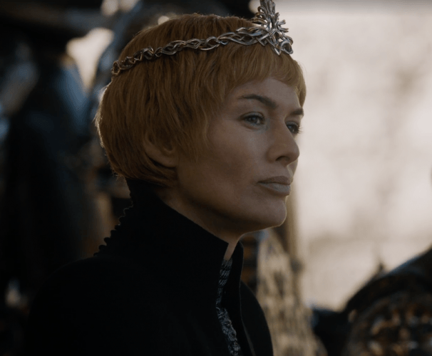Cersei wears a crown and looks outward.