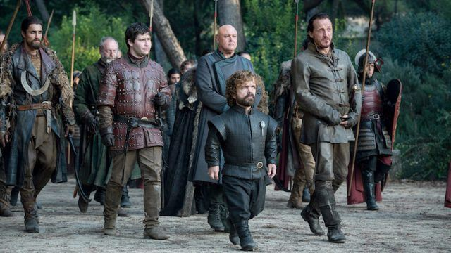 Tyrion walks with Podrick and others to King's Landing.
