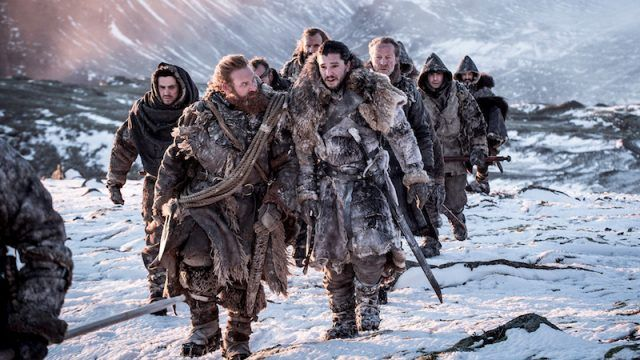 Jon Snow leads his group of soldiers in the snow.