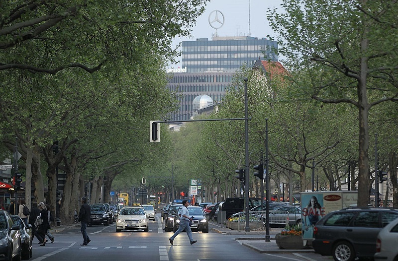 BERLIN, GERMANY - APRIL 27: Cars stop at a stoplight on Kurfuerstendamm avenue on April 27, 2011 in Berlin, Germany. Kurfuerstendamm, known locally as Ku'damm and which is the shopping and cultural heart of west Berlin, is turning 125 years old this year. City authorities are planning a series of events and exhibitions to mark the annivrsary starting in May. The the avenue has existed as a thoroughfare since the 17th century, though its pavement was first completed in 1886. During World War II many of the buildings along its route were destroyed by Allied bombing, resulting in an architectural mix today that blends pre-war and post-war, especially 1960s and 1970s, architecture.
