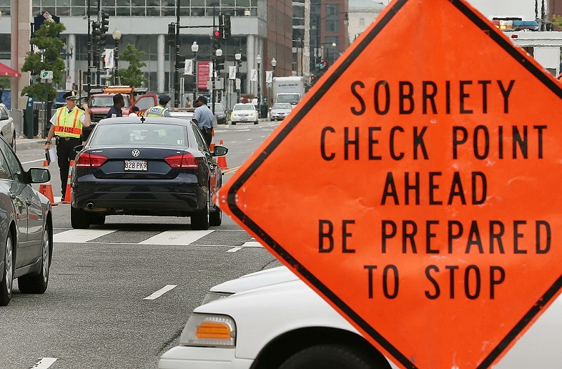 WASHINGTON, DC - AUGUST 14: Washington Metropolitan Police conduct a sobriety check point associated with a news conference on drunk driving, on August 14, 2012 in Washington, DC. The National Highway Traffic Safety Administration (NHTSA) held a news conference to discuss the national anti-drunk driving campaign and law enforcement crackdown.