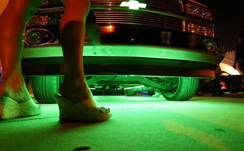 DAYTONA BEACH, FL - MARCH 27: Neon glows from under a truck during the Spring Break Nationals Glowoff Competition March 27, 2004 in Daytona Beach, Florida. A glow-off is a competition of lighting accessories such as neon lighting kits, strobe lights, LED lights and other 12-volt lighting accessories. Vehicles entered in the glow-off vie for cash prizes and best interior lighting and best exterior lighting awards. Judging is based upon creativity, cosmetic integration and installation integrity.
