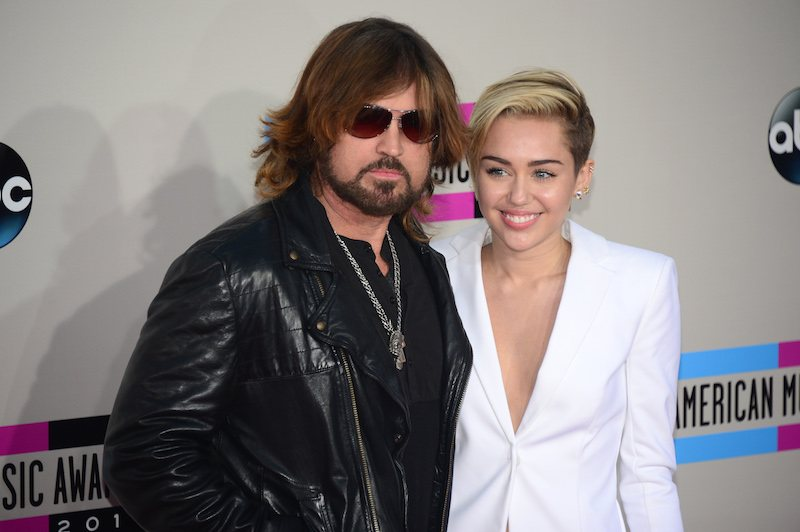 Miley Cyrus (R) and her father Billy Ray Cyrus arrive for the 2013 American Music Awards at the Nokia Theatre L.A.