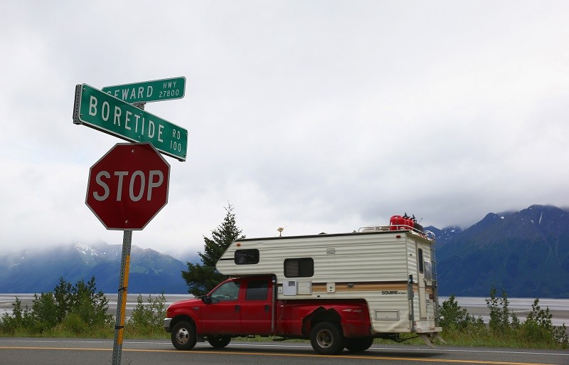 ANCHORAGE, AK - JULY 11: A truck passes a street sign named for the Bore Tide at Turnagain Arm on July 11, 2014 in Anchorage, Alaska. Alaska's most famous Bore Tide, occurs in a spot on the outside of Anchorage in the lower arm of the Cook Inlet, Turnagain Arm, where wave heights can reach 6-10 feet tall, move at 10-15 mph and the water temperature stays around 40 degrees Fahrenheit. This years Supermoon substantially increased the size of the normal wave and made it a destination for surfers.
