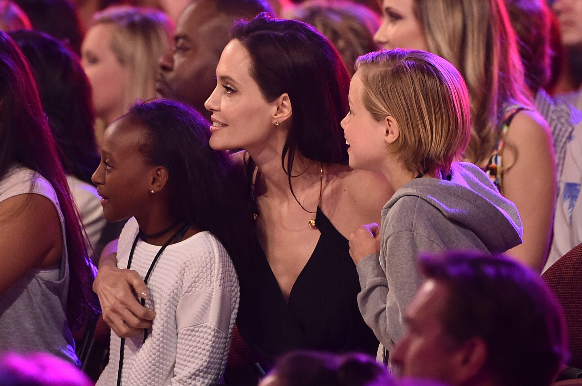 actress Angelina Jolie hugs Zahara Marley Jolie-Pitt and Shiloh Nouvel Jolie-Pitt