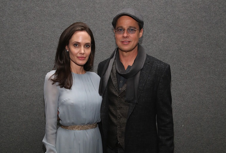 Angelina Jolie (L) and Brad Pitt attend an official Academy Screening of BY THE SEA hosted by The Academy Of Motion Picture Arts And Sciences