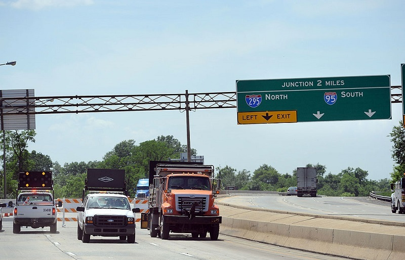 WILMINGTON, DE - JUNE 04: Trucks and barriers block the entrance to I-495 north to the bridge over the Christina River June 4, 2014 in Wilmington, Delaware. The bridge was closed indefinitely after four support columns were discovered to be tilting.