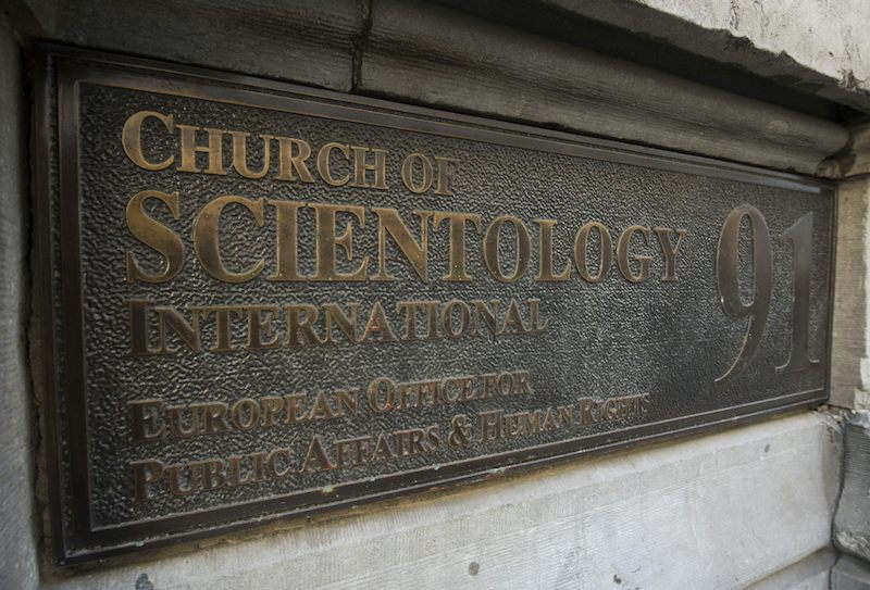 A close-up look at a Church of Scientology sign on a church in Brussels