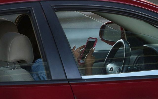 Driver texts behind the wheel on April 30, 2016 in New York, New York.