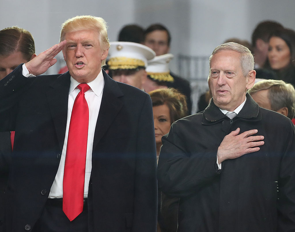 President Donald Trump stands with Secretary of Defense James Mattis.