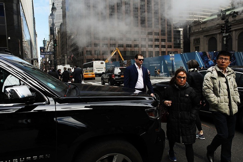 Chevy Suburban stops in the middle of an intersection while pedestrians try to cross on March 30, 2017 in New York City.