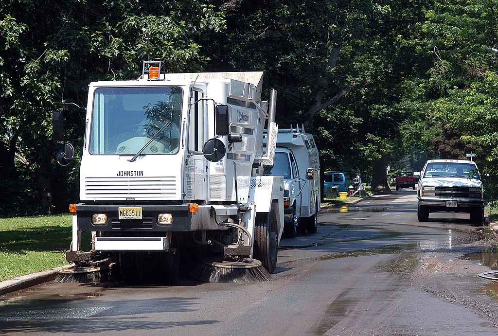 A street sweeper cleans the street in New Jersey, unrelated to any Trump event