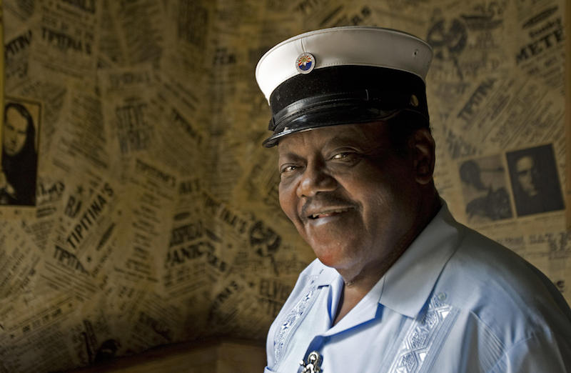 """New Orleans resident and legendary pianoman Fats Domino pauses a moments for a photo after meeting with reporters 19 August 2007 to talk about his new 2- disk album """"Goin' Home: A Tribute to Fats Domino"""" to be released 25 September 2007. The album is full of music's superstars with the expected large royalties going to to his Tipitiana's Foundation, with the mission of preserving the musical culture of New Orleans and the building of a lower 9th ward cultural center. AFP photo/Paul J.Richards (Photo credit should read PAUL J. RICHARDS/AFP/Getty Images)"""