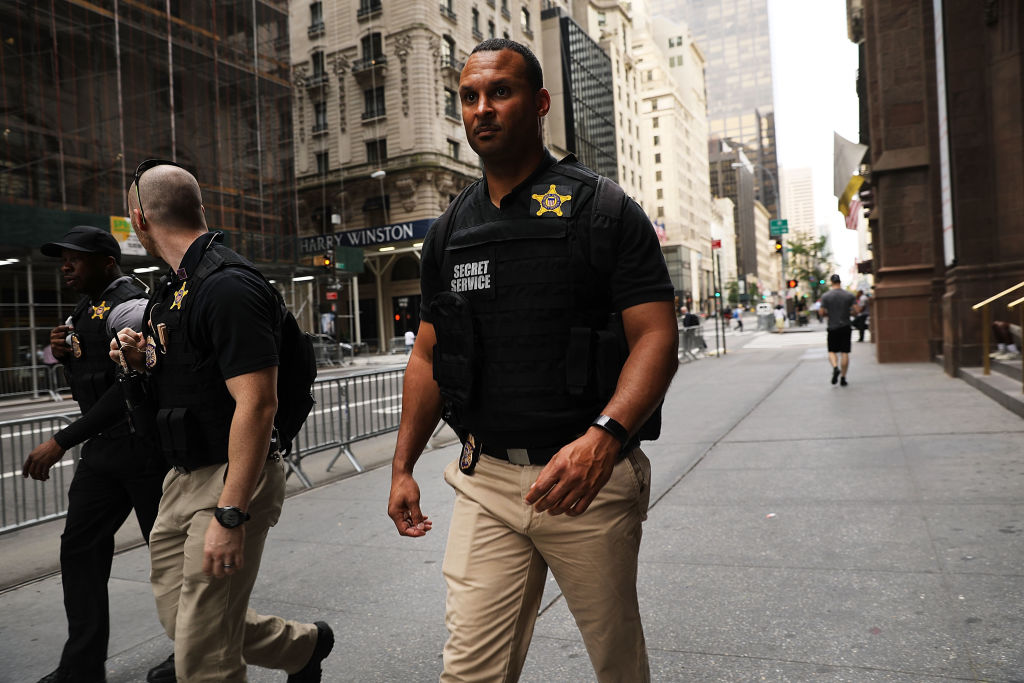 Members of the Secret Service walk in front of Trump Tower
