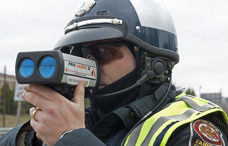 A Fairfax, Virginia, motorcycle Officer aims his ProLaser III, Lidar, towards drivers that may be speeding March 10, 2009, on Lee Highway-Route 29.