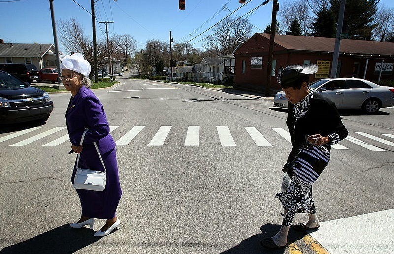BECKLEY, WV - APRIL 11: Dorothy Payne (R) and Minnie Shepard walk across the street to attend a funeral service for coal miner William Roosevelt Lynch, on April 11, 2010 in Beckley, West Virginia. Mr. Lynch was killed on April 5, along with 28 other coal miners when a methane-gas explosion occurred at the Massey Energy Company's Upper Big Branch Coal Mine.