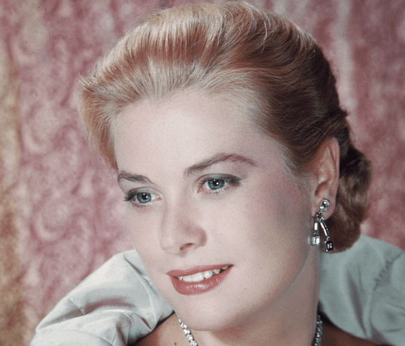 Grace Kelly poses with a gown and elaborate jewelry.
