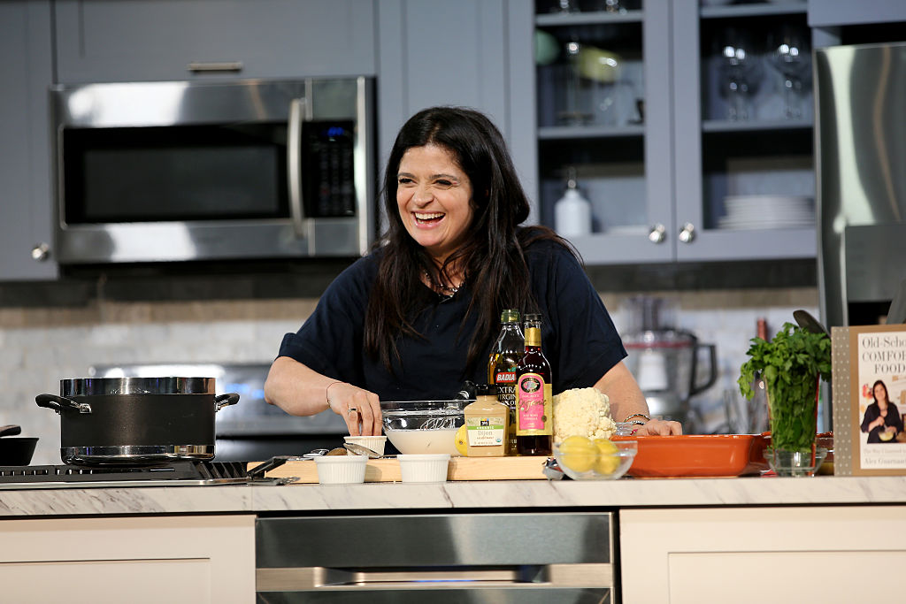 Chef Alex Guarnaschelli prepares food on stage during the Grand Tasting presented by ShopRite