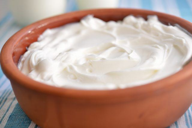 Fresh Greek yogurt in a wooden bowl.