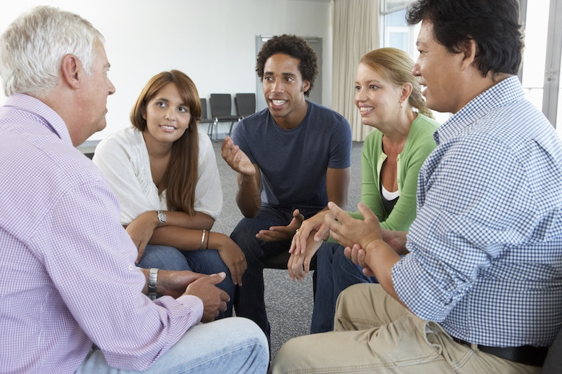 A support group sitting in a circle and talking