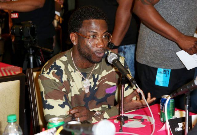 Gucci Mane speaking to the press at the Radio Broadcast Center in 2017.