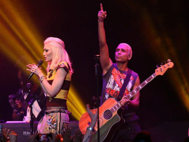 Gwen Stefani and Tony Kanal performing onstage