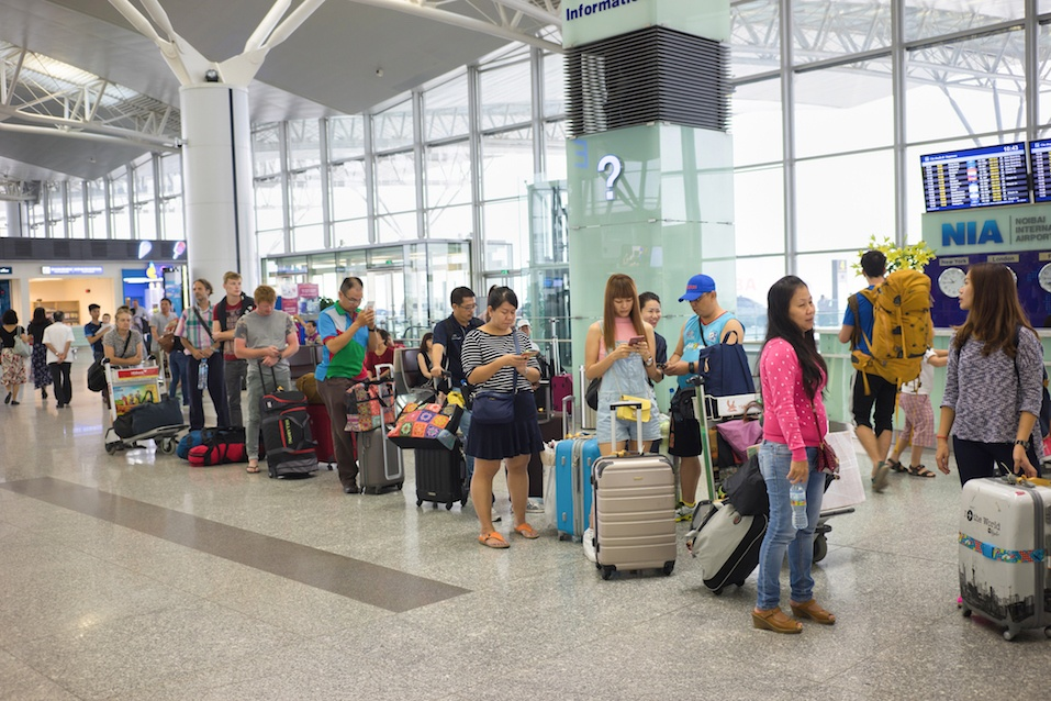 Queue of Asian people in line waiting at boarding gate