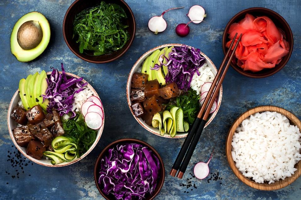 Hawaiian tuna poke bowl with seaweed, avocado, red cabbage, radishes and black sesame seeds