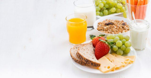 A healthy breakfast laid out on a white table.