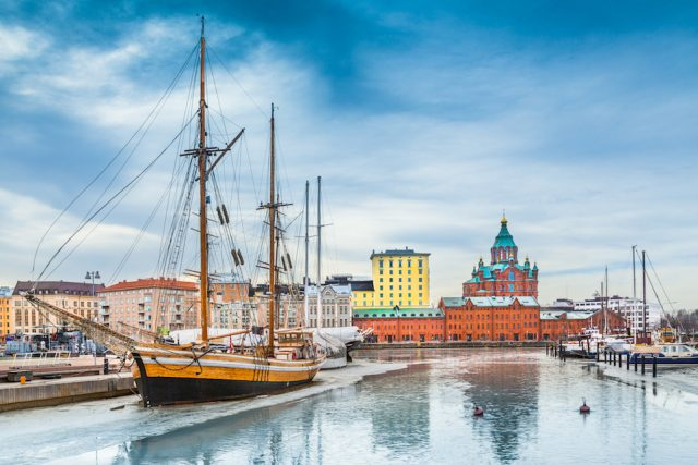 Helsinki harbor district with Uspenski cathedral in winter, Finland