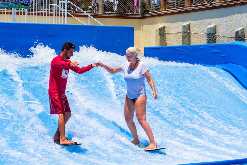 A visitor enjoying the wave riding flowrider attraction at the Margaritaville Resort