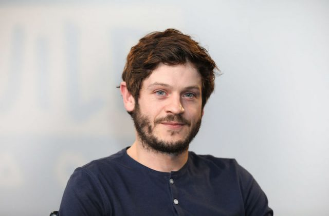 Iwan Rheon poses for photos at a press panel in London.