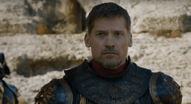 Jaime Lannister stands outside looking straight ahead.