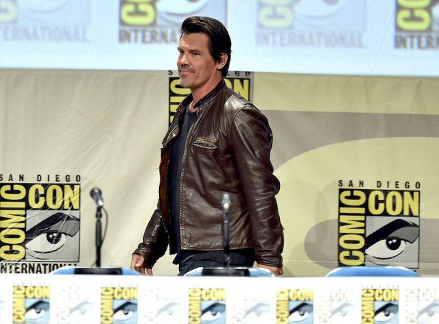Josh Brolin walks on stage at a panel at Comic-Con with the cast of 'Sin City: A Dame to Kill'.